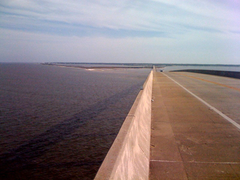 This is the view from the top of the 115 ft bridge. Note the giant shadow in the water and Dauphin Island in the distance