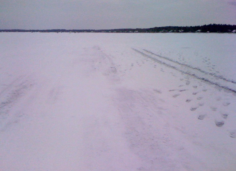 Tracks in the ice on a mostly frozen Shell Lake. There were only snow mobiles on the lake. The only truck stayed really close to shore. I wasn't going to try to go all the way across the lake yet.