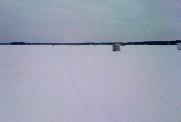 Ice fishing huts on the lake