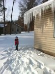 Josiah next to icicles as tall as him!