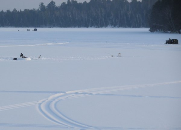 Ice fishing in half an igloo