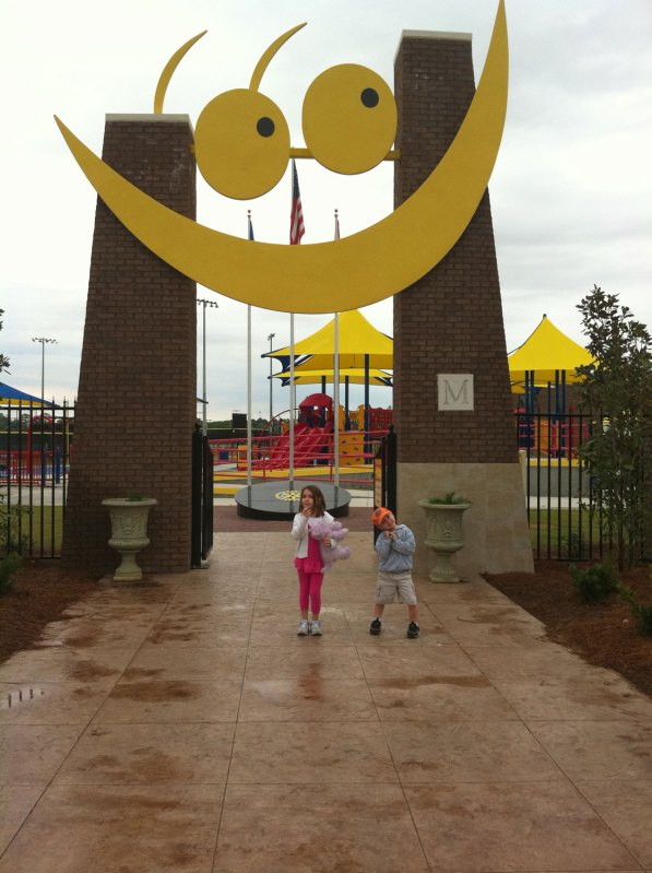 Analise and Josiah strike a pose in front of Miracle Field
