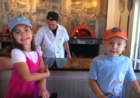 Watching the chef prepare our food at the Woodfire Grille