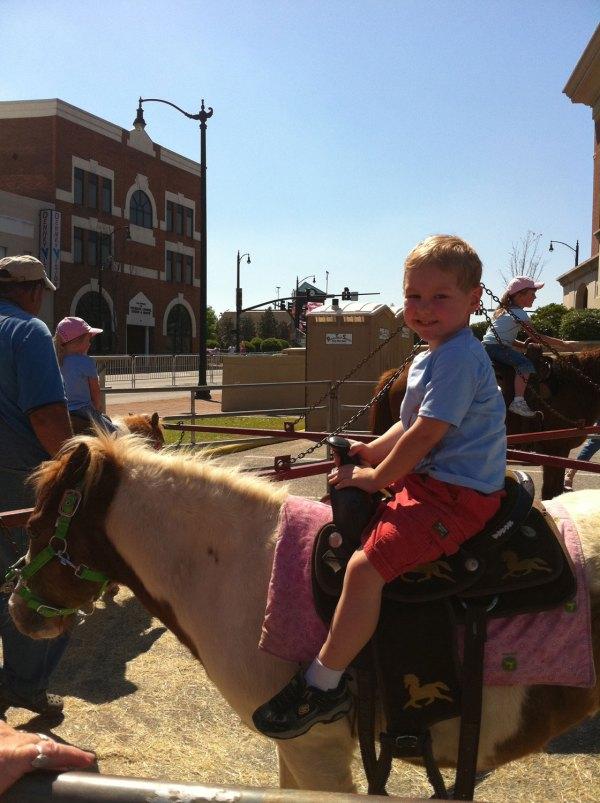 Josiah enjoying a horse ride.