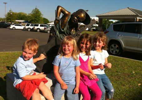 The Moon and Toone kids near a cool sculpture