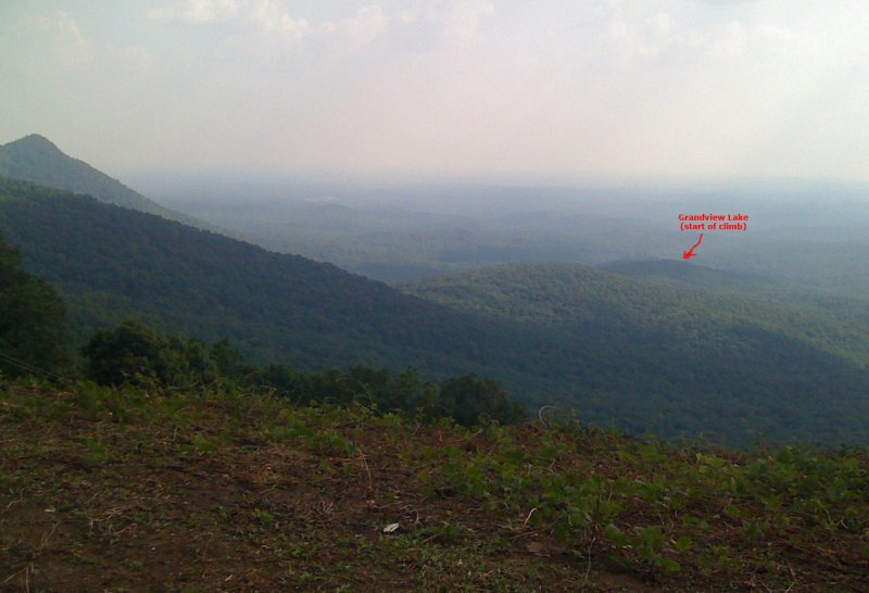 Here is the view from the GA-136 overlook about a mile from the summit of Burnt Mountain. You can just barely see the road that passes by Grandview Lake marking the start of the climb.