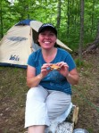 Kristine enjoys smores while camping