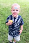 Josiah shows off his snow cone and tattoo -- cute gecko