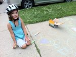 Analise cheers for me with chalk on the sidewalk