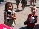"Analise and Josiah show off their cowbell cows which cheered ""mooooove up"" throughout the race"