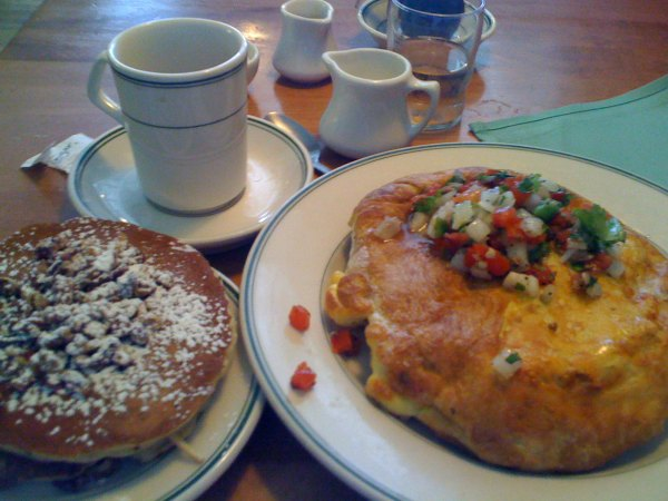 Breakfast at the original pancake house - pecan pancakes and fiesta omelette