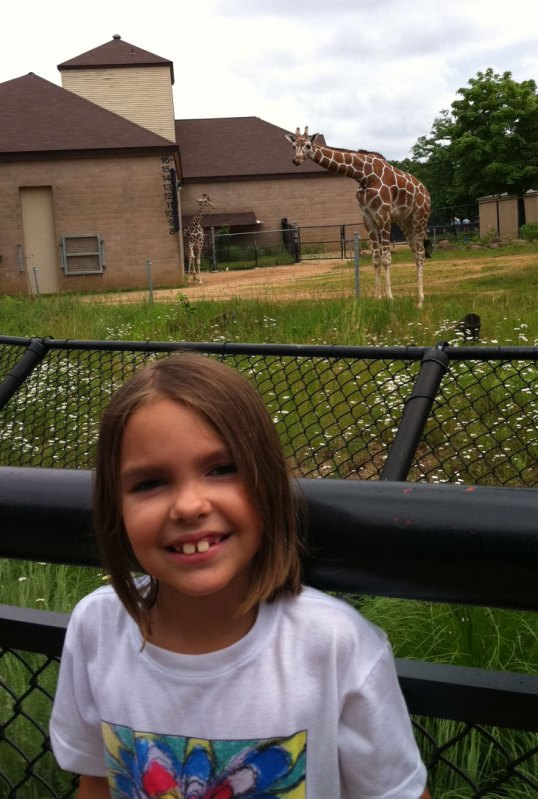 Analise with her favorite giraffe