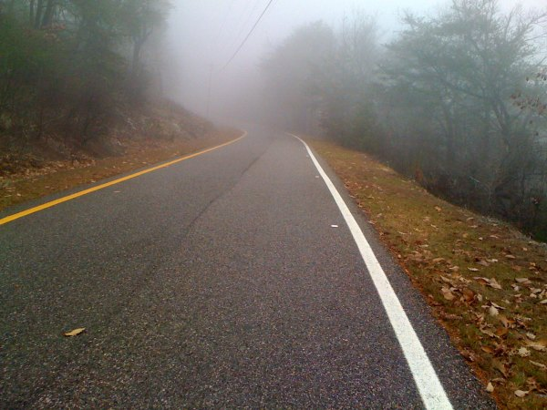 The one-way road to the top disappears into the clouds