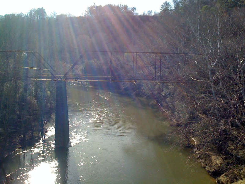 View of an abandoned railroad bridge to the southwest