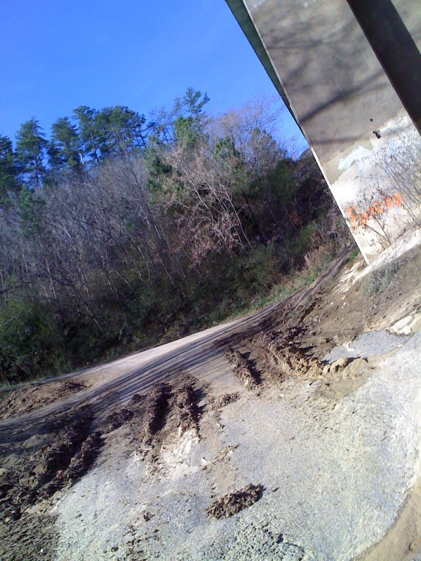 Looking up the start of the boat ramp from directly underneath the bridge