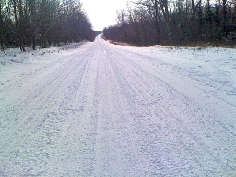 The end of Telemark Rd - Up ahead in the distance you could see where Telemark Rd turns into Co Rd O, which was plowed and paved. My old iphone 3g camera apparently couldn't see it.