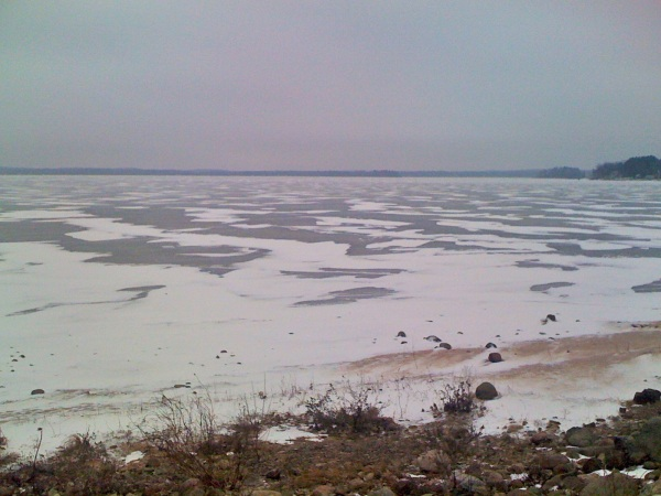 Snow drifts on the lake. You can ride your mountain bike on the lake as long as you stay in the snowy areas. It is fun to try to map out your route from one snow drift to the next to minimize the areas of open ice that you have to cross. It is also possib