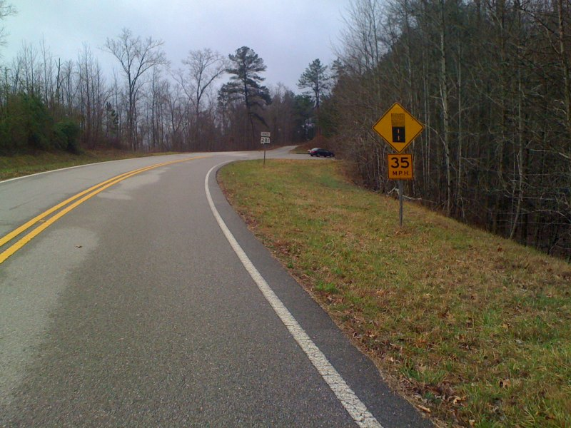 The top of the Adam's Gap climb at the point where the road turns to gravel
