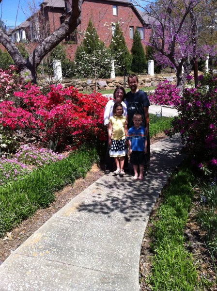 our family underneath redbud in shadow of dogwood