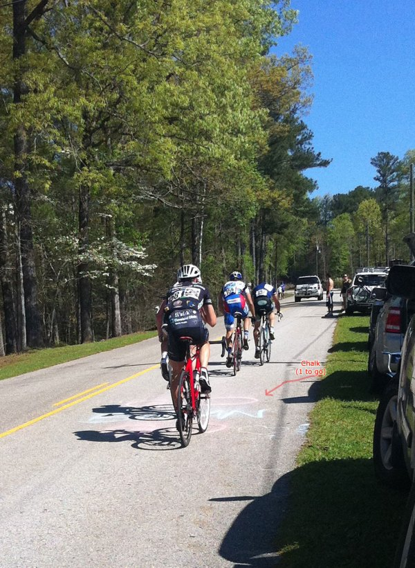 Our final four-man break with one lap to go. We definitely needed encouragement as the chase group was bearing down on us.
