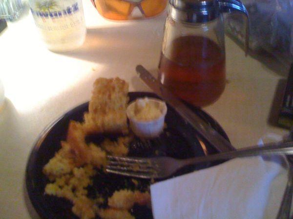 Cornbread with nearly half bottle of honey already gone