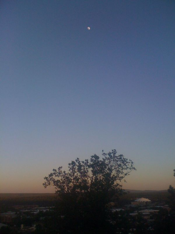 View of the moon rising over Flagstaff