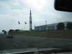 Rockets at the rocket center - one is standing, the other is inside the building separated into its stages