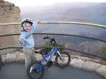Josiah showing the view looking west ... note we were able to ride to the edge of the canyon because Maricopa was empty!