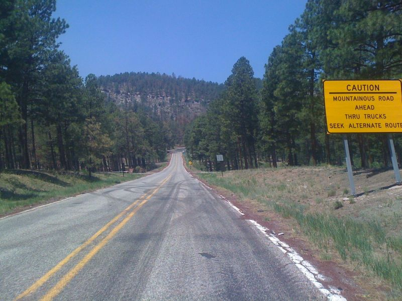 Day 17 - I love these kinds of signs. This one is at the bottom of the climb up the Valles Caldera rim.