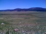 Day 17 - elk far below in the Valles Caldera (may not show up in the crappy iphone 3 camera)