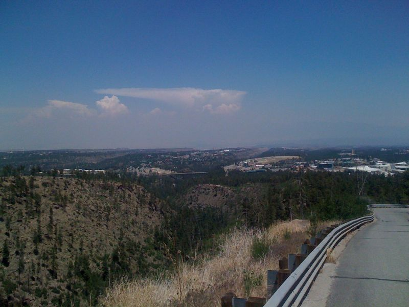 Day 17 - about a mile into the Pajarito Ski Hill climb looking down at the starting point below the iconic bridge connecting the Los Alamos lab area with the rest of town