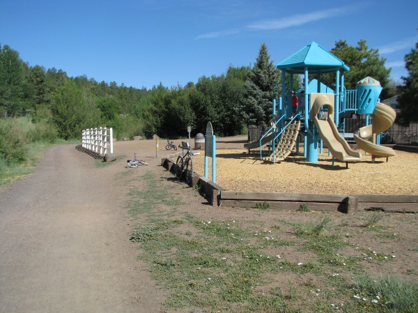 Playing on a playground alongside the Flagstaff urban trail