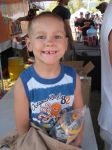 Josiah got in on the schwag toss at the awards ceremony - getting a cool water bottle. Ken Chlouber got the t-shirt and then gave it to Josiah, who wore it to stay warm!
