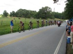 The main Cat 4 field going through the feedzone on the start of their second lap