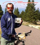 Prizes from the Leadville Trail 100 MTB race - big belt buckle and full zip jacket. Mt Massive is annotated in the background. (click to enlarge)