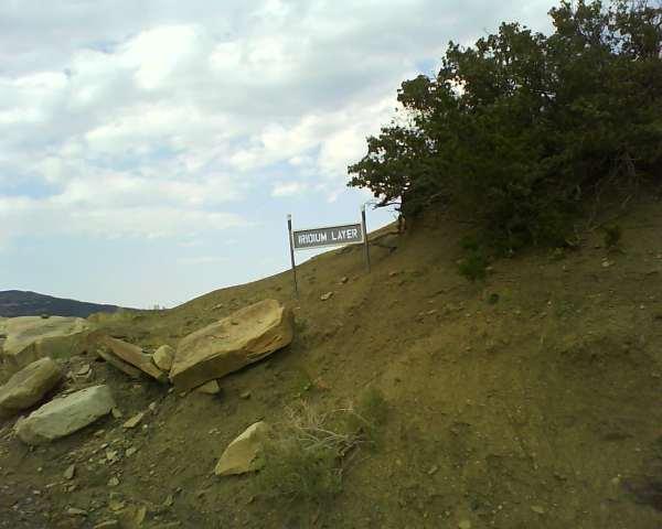 """Climbing out of Raton, NM - sign says """"Iridium Layer"""""""