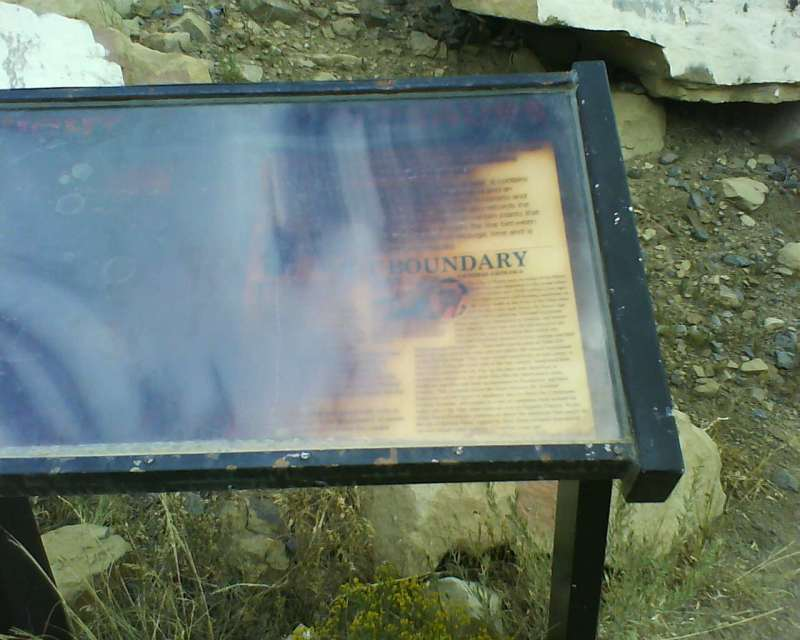 Informational sign burned by perhaps a forest fire?
