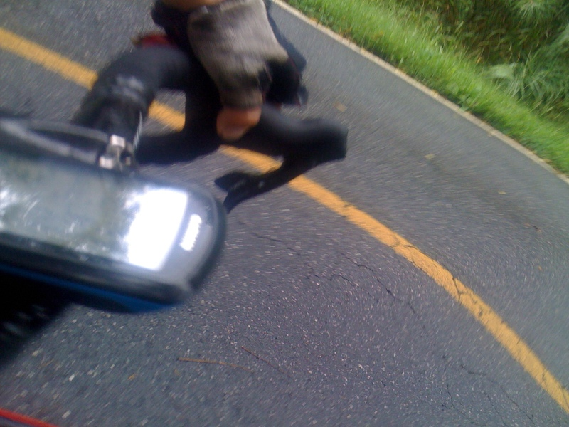 This was an accidental picture as I was taking out the camera, but this picture is so intriguing to me for a number of reasons. First, it is an unexpected glimpse of my hand, glove, handlebar, garmin, and tire in the middle of what was a very isolated warm-up ride in a very rural part of the area (I was passed by maybe 5 cars the entire time I was on the Clemson side of I-85). Second, there is so much of the picture that is out of focus and/or warped because of camera movement, but there is a section of the road that is nearly perfectly in focus and you see the cracks in the pavement, small rocks in the asphalt, a couple pieces of pine straw on the wet pavement - and for some reason that makes this picture capture more of the essence of the ride then your typical scenery picture.