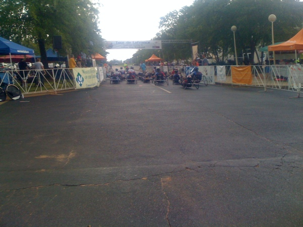 The handcycle race about to start in the light rain.