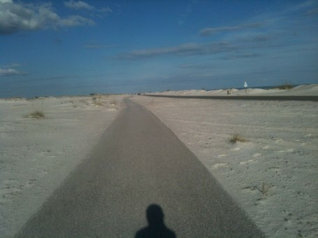 Cool, clean bike path through the dunes next to the road