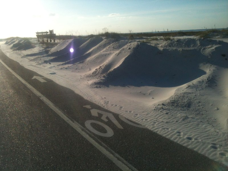 Sand blowing into the bike lane