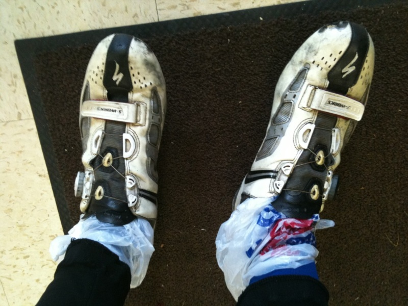 If you are caught in cold, wet weather and woefully underdressed then plastic grocery bags worn like socks make for excellent wind-proof shoe covers inside the shoe. My feet were freezing before this stop and afterwards stayed toasty warm for the rest of the ride.