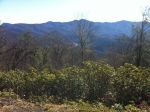 View from Wolf Laurel Gap looking down towards US-19 ... Waterrock Knob is towards the left and you can just barely make out the road climbing up it