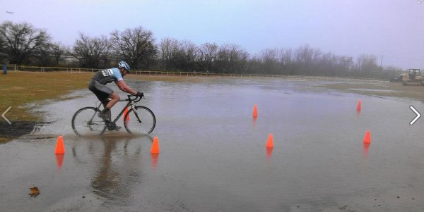 Alan Barton rides through one of the lake puddles.