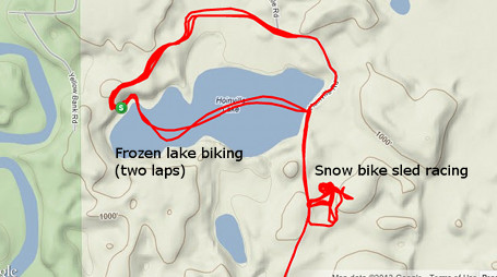 Frozen lake riding and snow bike sled racing at the beginning of the ride