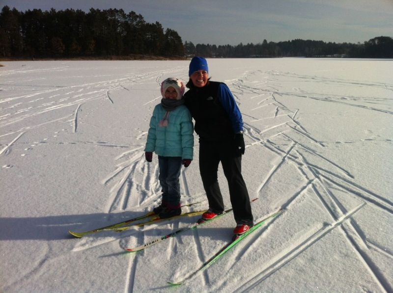 Analise and Kristine snow skiing on the lake