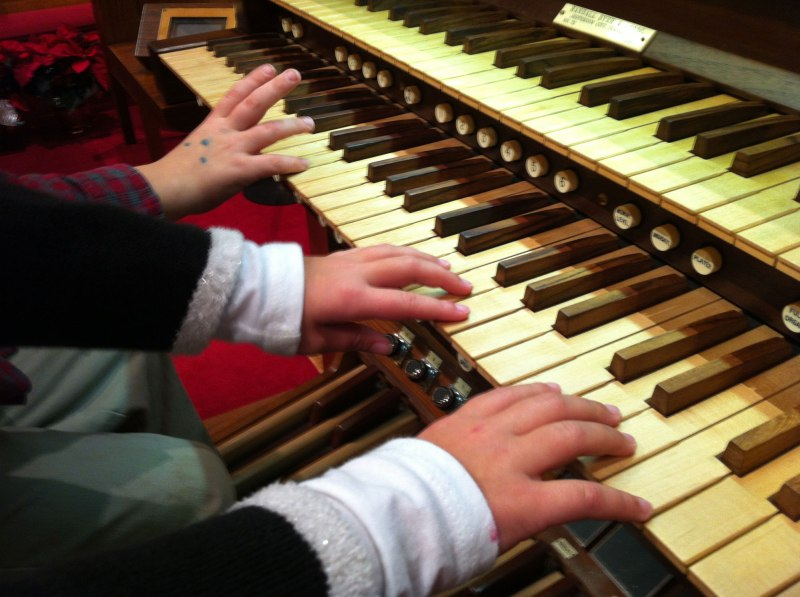 Josiah and Analise pretend to play the organ after Matthew's Christmas special