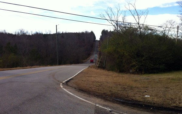 Steep (22%) downhill on Liles Ln off one of the foothills of Goodner Mtn.