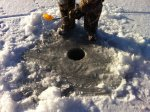 Keeping an ice fishing hole open (simply scoop out some water every few minutes)