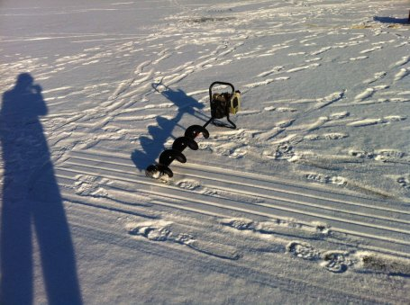 Auger for drilling ice fishing holes